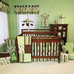 Nursery room decor idea with wooden baby crib small nursery chair in green folded baby changing desk