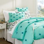 Reversible turquoise and white bedding set with textured ball decorations