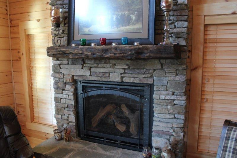Shabby and reclaimed wood mantel installed over a rustic style fireplace - Reclaimed Wood Mantels For A Rustic Or Antique Fireplace Look