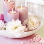 Simple candle centerpiece for table with fresh flowers