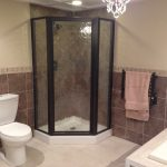 Standup shower room with glass door white toilet built in white bathtub built in towel stall