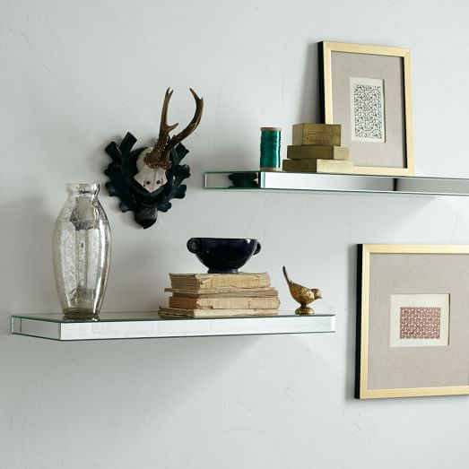 Mirrored wall shelf a smart way to add your home interior for Shelf decor items