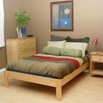 Unfinished wood Zen platform bed frame in simple style and in standard size size a wood bedside table with drawer a corner wood storage unit with drawers