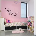 Washable pink wall paint applied on kids' room wall system a twin sized bed frame with storage underneath a pink bedroom mat a miniature of castle in pink a ceiling light fixture