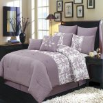 White and light purple bedding set with small flower motifs for standard size bed frame with curly headbord