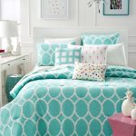 White and turquoise bedding set product in modern motifs