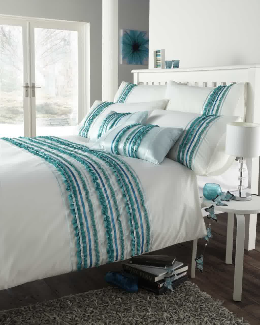 white bedding set with turquoise strips decoration in standard size bed with white wood headboard gray