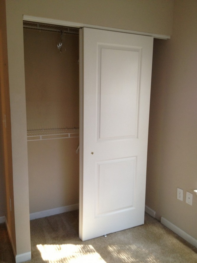 White Sliding Closet Door Made Of Solid Wood With Casters