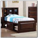 captain bed frame design in dark brown finish and shelves on its headboard
