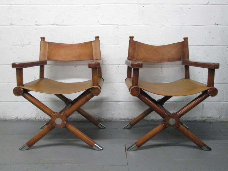 A Couple Of Leather Director Chairs With X Base Made Of Bamboo