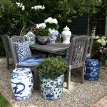 A set of garden furniture with blue and white stools