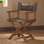 Dark leather director chair with x base and hardwood frame