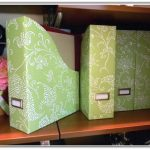 Fresh green magazine holders with white floral motifs