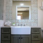 Large farm sink idea in white for a modern bathroom a vanity mirror with patterned ceramic tiles a couple of vanity lamps over sink