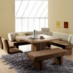 Luxurious dining bench with brown velvet slipcover L shaped dining bench with white back feature gray fluffy area rug