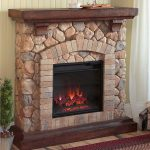 Modern stone framed electric fireplace with transparent glass door and hardwood fireplace mantel