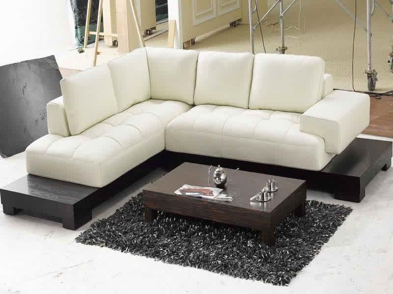 modern white sectional sofa in l shape dark finished wooden coffee