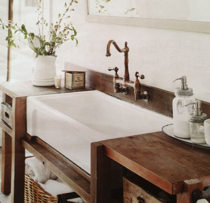 Oversize Farm Sink In White With Bronze Water Faucet A Bathroom