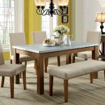 Soft beige upholstered dining bench with other dining furniture sets