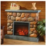 Stone framed electric fireplace with concrete mantel