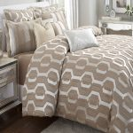 White and beige bedding set for a modern bedroom