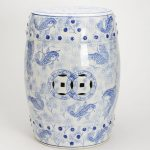 White and blue garden stool with fish pictures