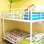 White metal kids loft bed IKEA with built in ladder