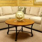 small corner sectional sofa for small living room round wood top center table with decorative item at the center