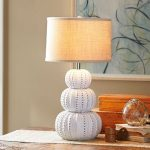 white pyramid sea urchin base lamp with light brown lampshade