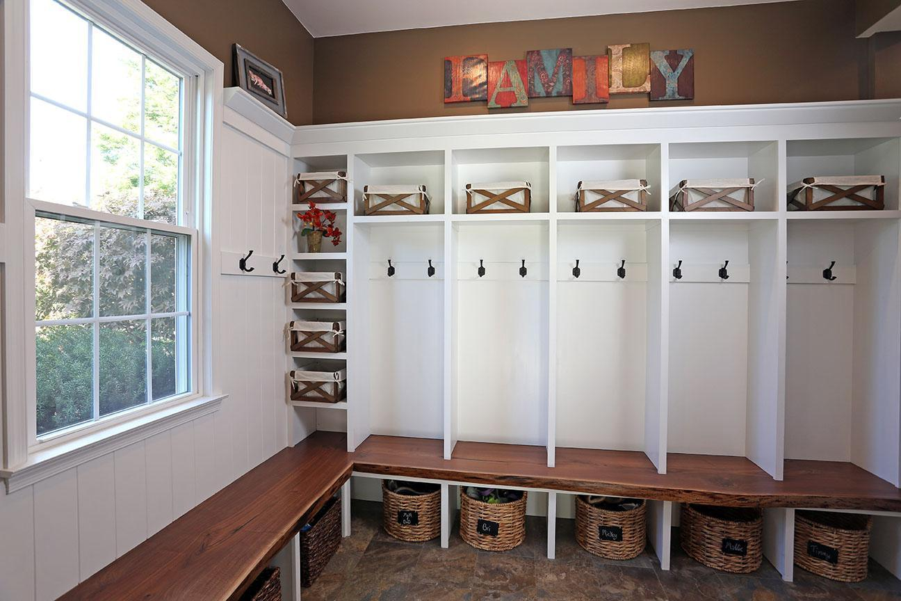 Mudroom-lockers-with-black-walnut-bench-top-and-white-paint-wooden-material