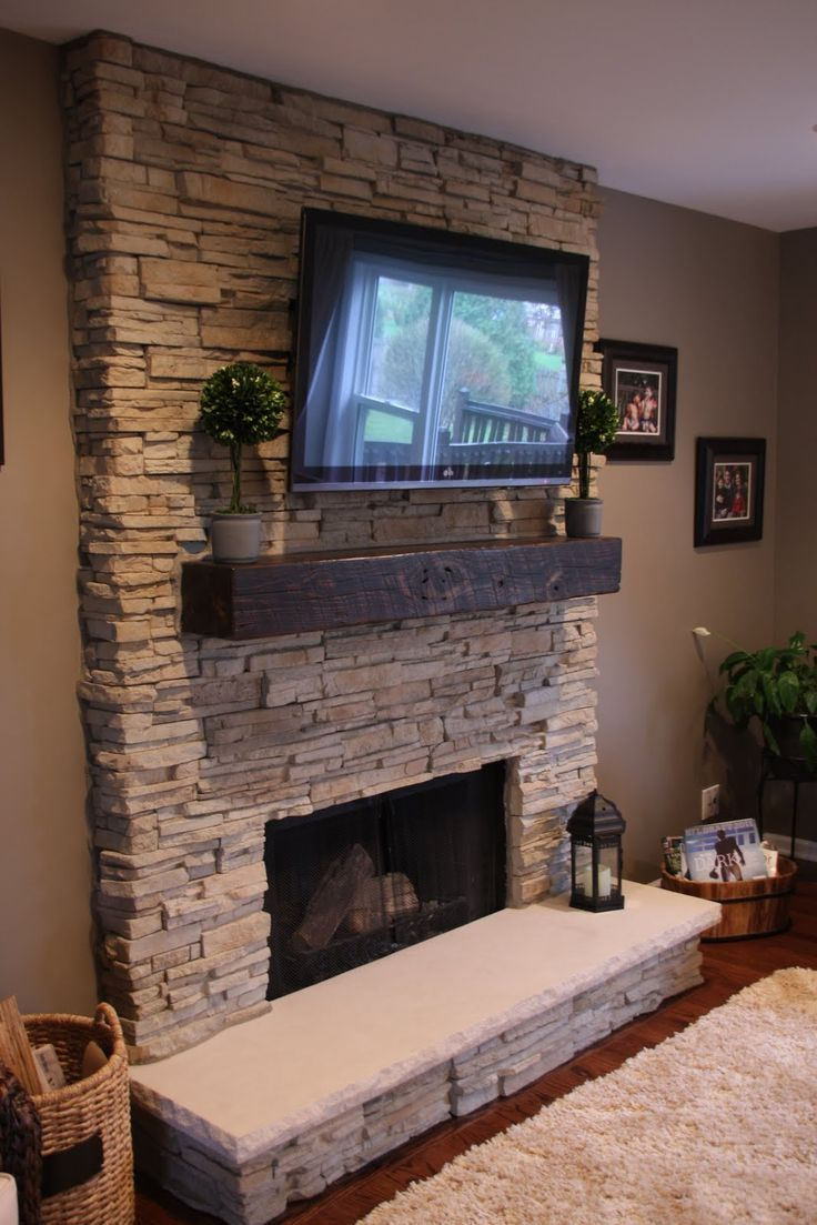 Elegant firepit with unpolished panel of oak wood using ornamental -  008 Lavish Fireplace With White Concept Of Stone Panel On Mantel And Widescreen Television Above Shelf Of Firepit On Conrete Interior Design Jpg