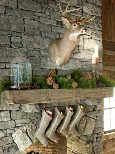 Delightful Fireplace Decoration with Christmas Ornament and Animal Sculpture using Socks on Wooden Panel of Rustic Model Fire Mantel