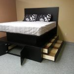 Enchanting Bedroom With Floating Platform For Storage Installation Painted In Black With Striped Bed Cover Also Floral Pattern For Pillow On Minimalist Room