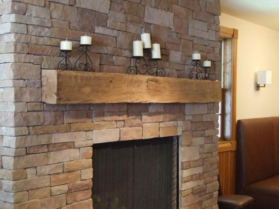 Magnificent Fireplace with Rustic Unpolished Brick with Wooden Panel on Firepit also Candle Panel on Shelf without Ornaments to Embrace Room Decoration