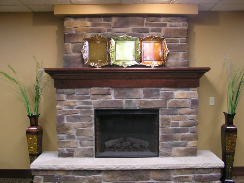 Fascinating Fireplace with Cracked Stone Polsihed with Glossy Shield and Wooden Shelf for Firepit without Ornaments using Mirror Decoration