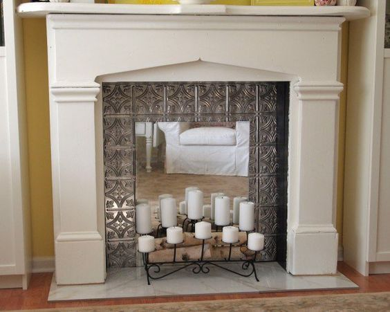 Mesmerizing Fireplace with Candle Place on Steel Ornamental and Ornamental Mantel with Concrete Construction on Firepit on Minimalist Interior