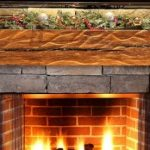 Magnificent Fireplace With Unpolished Stone For Fire Mantel And Wooden Firepit For Block With Tropical Plant On Minimalist Room With Peach Interior Design