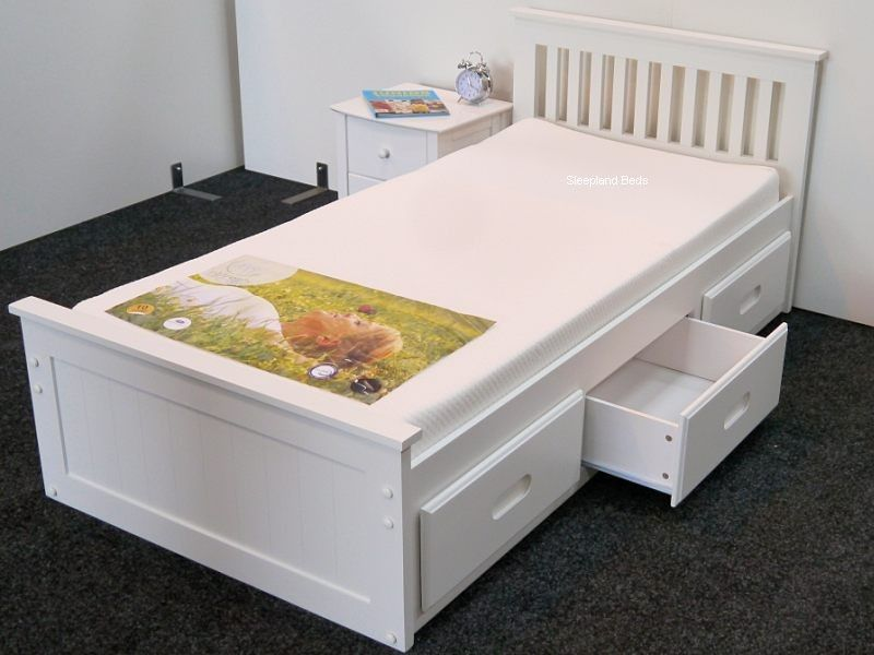 Minimalist Bed Platform Model painted in White with Large Storage and Animal Printing on Cover also Headboard with White Interior for Suburbs House