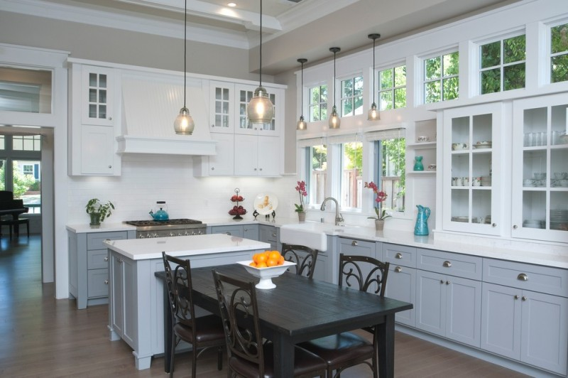 L shape kitchen and dining room dark dining table and chairs white countertop white top island grey under cabinets white upper cabinets