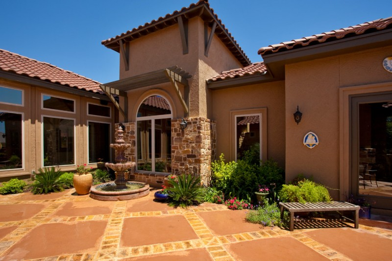 Get italian appeal with these attractive tuscan style for Tuscan roof house plans