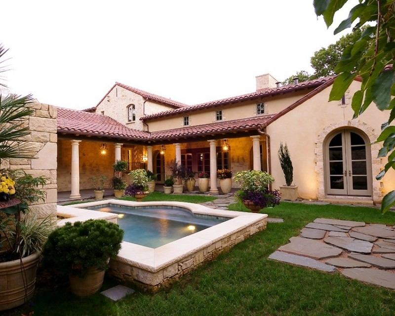 Mediterranean Tuscan style home image with back yard and pool
