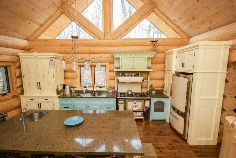 Mix Rustic Victorian kitchen large marble toned kitchen island shabby white storage light blue cabinet dark marble countertop stainless steel appliances classic pendant lamp log wall idea