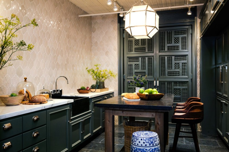 Oriental kitchen design porcelain side table with motifs black top dining table higher base dining chairs giant lampion lighting white marble countertop textured backsplash