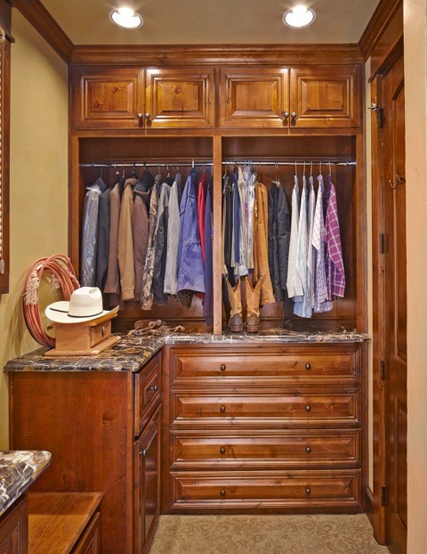Western style dressing room design closet organization with upper cabinets lower drawer system and chrome hang sections