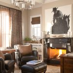 Western Style Room With Black Leather Reading Chairs Black Leather Center Table Contemporary Fireplace Pale Beige Fury Rug And Cowboy Wall Art
