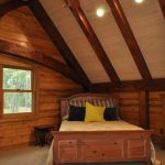 Bedroom Idea In Log Home Vaulted Roof Ceiling Fan Bed With Wooden Headboard Wooden Slabs Walls System Medium Sized Mat