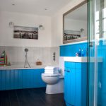 Cool Blue Vanity Idea With White Surface And Dark Wood Frame Vanity Mirror