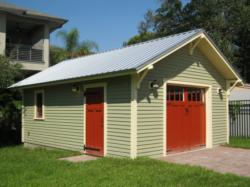 custom car garage door in red with pastel finishing wall system
