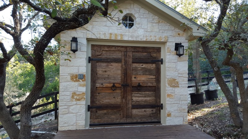custom cedar garage door with iron hingers rustic limestoned car garage