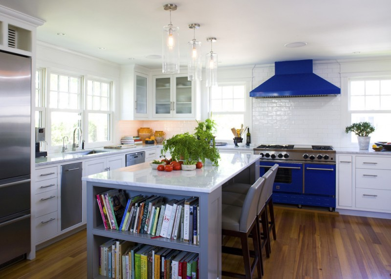 dark blue covered appliances white tile backsplash huge white kitchen island with recipe book storage white cabinet idea a couple of grey dining chairs